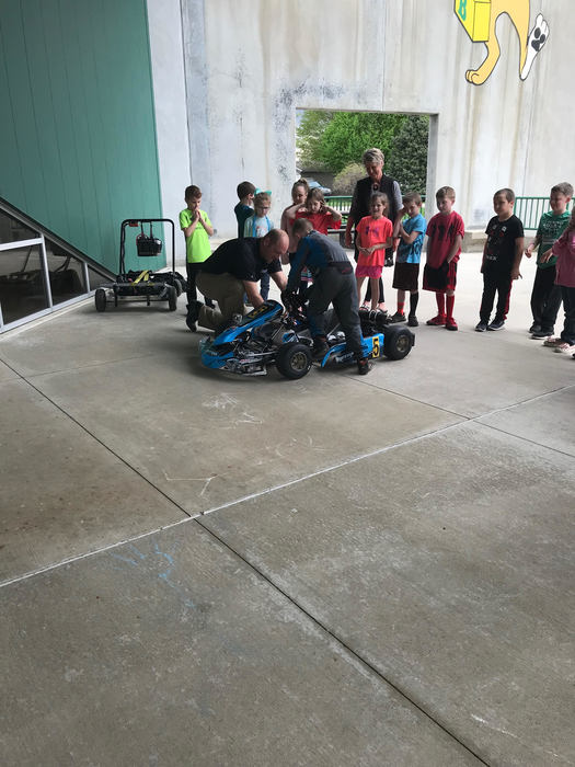 Caleb demonstrating his Kart